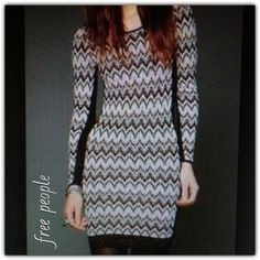 "♣️ Free People metallic chevron bodycon dress This is a gorgeous Free People long sleeve chevron bodycon dress. Made of cotton acrylic and metallic. Size medium. Lowcut back and solid side stripes for a slimming effect. Size medium. Bust 34"" waist 29"" length 36"". Never been worn new condition.   All items are from a clean, smoke free home  Please use the offer button... We will not answer ? on price in the comments.   Trades  Modeling Free People Dresses Midi"