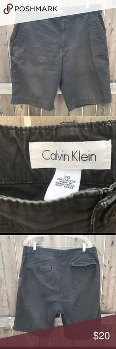 Calvin Klein Charcoal Gray Cargo Shorts sz 36 Calvin Klein Dark Gray Cargo Pocket Shorts   Size 36 (refer to measurements)  Good condition just has fading!  Waist laying flat: 18 inches  Leg Length: 23 inches  Inseam: 11.5 inches  All measurements are taken with items laying flat!  If you have any questions please message me thanks!  Check out my other listings! Calvin Klein Shorts Cargo