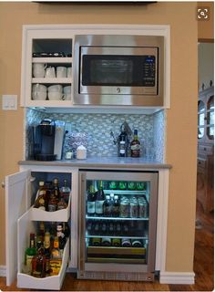 Add ice maker next to wine fridge, coffee center on top of counter. Open shelves next to microwave?