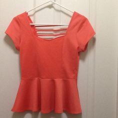 Junior's Top Very comfortable and light, gently used. Orange/Coral color. Save 15% on 2 + bundle and shipping .  Tops
