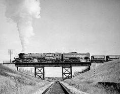 Duluth, Missabe and Iron Range train on railroad bridge west of Two Harbors, 1940. http://www.lakesnwoods.com/TwoHarborsGallery.htm