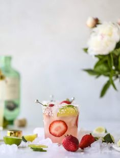 smoked strawberry mezcal margaritas I howsweeteats.com #margaritas #mezcal #strawberry #lime