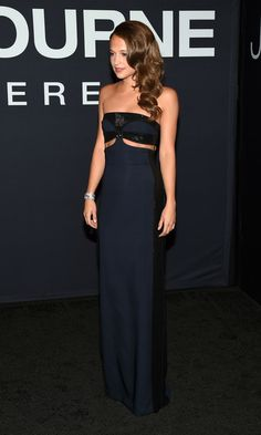 Alicia Vikander Cutout Dress - Alicia Vikander sported her favorite brand, Louis Vuitton, at the 'Jason Bourne' premiere: a strapless navy number with a pair of midriff cutouts and black sequin detailing.