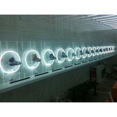 shoe display, neon light highlighting each style