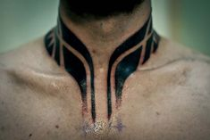 Polynesian style neck collar tattoo