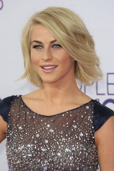 Julianne Hough keeps her bob from looking too heavy with long layers and sweeping bangs. She also flips the hair at the bottom out slightly to add texture. #ThickHair #Hair