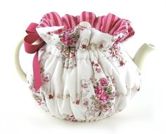 french rose tea cozy - I think I'm going to crochet one in this style - wrapped from the bottom up instead of covering top down. Seems more useful?