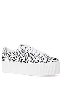 The CYA Guns Sneaker in White With Black Words by Jeffrey Campbell