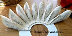 book page wreath tutorial, crafts, wreaths, Simply fold pages and glue onto a wreath form Mine is made from a piece of foam core Old Book Crafts, Book Page Crafts, Book Page Art, Old Book Pages, Folded Book Art, Book Folding, Wreath Crafts, Diy Wreath, Paper Wreaths