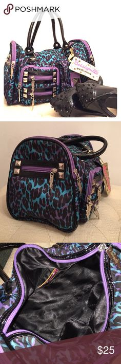 Betsey Johnson Purse This bag will pair perfectly with a leather jacket. It contains many compartments to suit your needs! Dimensions: about 13 in wide by 8 in high Betsey Johnson Bags
