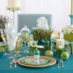 Colors...Spring colors and geometric centerpieces of tightly-bunched single blooms make this Easter tablescape fresh and modern. ....love the asparagus plant!!!