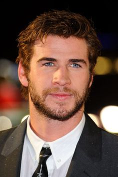 Born on January in Melbourne, Australia, Liam Hemsworth is the younger brother of actors Chris Hemsworth and Luke Hemsworth. Luke Hemsworth, Hemsworth Brothers, Wavy Hair Men, Australian Actors, Catching Fire, Beautiful Boys, Beautiful People, Hunger Games, Cute Boys