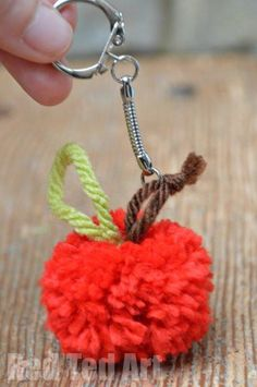 Apple Pom Poms. Super easy to make. Super cute, these apple pom poms are a great apple craft for Fall and Autumn. Use the apple craft for pretend play, or as a zipper pull/ key ring for Back to School. Makes a lovely gift for a teach too!