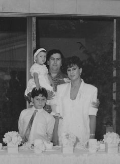 Escobar's family photo; Pablo Escobar holding Manuela, tugging on her brother's hair, Juan Pablo, and Maria Victoria Henao.