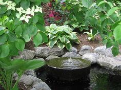 I like the idea of a millstone fountain in my front courtyard because it would be low enough not to be seen. The sound of the water would be a mystery until someone walks into the courtyard. However, the front yard is too formal for a pond like this.