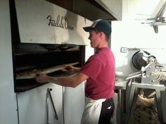 Making fresh pizzas at Bella Luna Cafe - Chicago