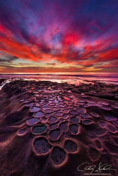 "Andrew Shoemaker Photography at Hospital Reefs in La Jolla, CA  -    ""Pacific Eruption""  -   This was one of the most intense sunsets that I've ever witnessed and it happened to be over a spot that had eluded me for a while. I had set out to this other worldly location several times hoping for a great sunset to reflect in the pools of water."