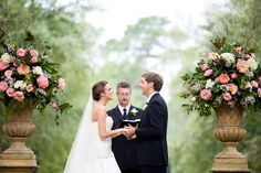 These urns are absolutely stunning! This whole wedding is gorgeous... lots of magnolia details