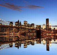 Manhattan Skyline and Manhattan Bridge At Night New York