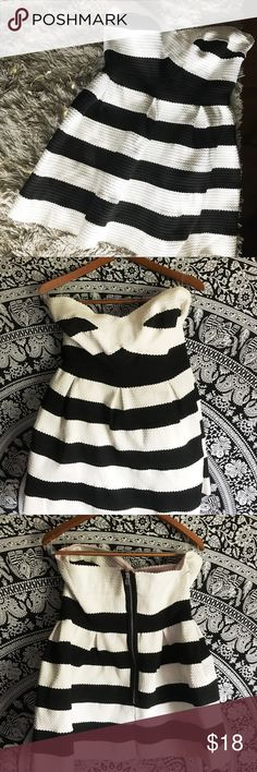 Strapless Black & White Stripe Dress Strapless Black & White Stripe Dress from Charlotte Russe. Fun and flirty strapless skater skirt dress. Can be worn for homecoming or prom! Rubber strap that holds the dress up is tinted pink, other than that, great condition. Comfortable and flattering. 74% polyester 14% rubber 12% nylon. Feel free to ask questions or ask for more pictures. Charlotte Russe Dresses Mini