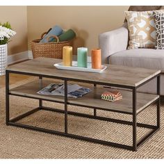 Another less-useful, simple, but acceptable design.  Simple Living Piazza Coffee Table