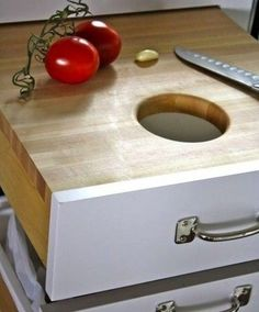 Hijack a drawer into a cutting board + scrap disposal station. Just install a wastebasket in the drawer below, fit in a butcher board and the convenient chute to the top drawer, and voila! Cleanup has never been easier.