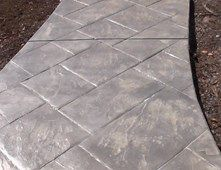 this ashlar stone stamped concrete is a sandy buff color and