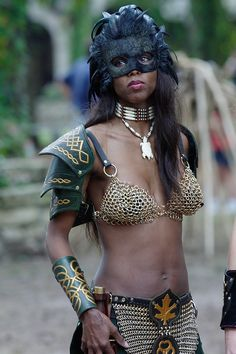 "Again with the bare midriff for extra deathiness. I almost Pinned this under Garb instead of Armour as it is so pointless as actual protection. - ""Nubian armor model - Today's Action Photo is a picture of a shapely Nubian lass modeling the latest in Lord Entropy's armor fashions for women at the 2002 Texas Renaissance Festival!"""