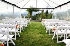 Protect guests from cool weather and still let them enjoy the outdoors by holding the ceremony under a clear tent