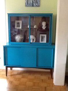 Mid Century Modern china cabinet that I painted In a beautiful Teal colour.