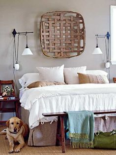 Antique tobacco basket mounted above the bed makes a headboard unnecessary. Burlap accent pillows and bedskirt complement the woven basket and jute rug.