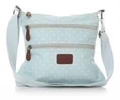 Shruti Dotty Spot Pale Blue Canvas Cross-body Bag £28.00 (inc VAT) Product code: 1337 Dotty spot canvas cross-body bag from Shruti.  Pale blue with white spots, zip top, adjustable pale blue canvas strap, external zip pockets and lined with internal zip and mobile 'phone pockets. www.melburygallery.co.uk