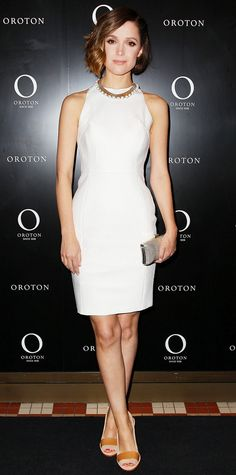 As the new face of Oroton, Rose Byrne stepped out for the event that was thrown in her honor, selecting a little white sheath dress with a pearl-studded statement necklace, a metallic Oroton clutch, and neutral peep-toes, for the occasion.