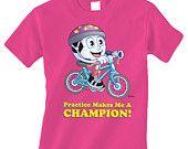 Raspberry Children's KICKER RIDES A BIKE Short Sleeve T-Shirt, Visit MySporties.com $20