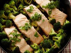 Hoisin Skillet Salmon : Salmon is a great source of heart-healthy fatty acids and looks beautiful on a bed of vitamin C-rich broccoli. Topped off with colorful red pepper flakes and fresh cilantro, this bright, low-calorie meal takes under 20 minutes. Fish Dishes, Seafood Dishes, Fish And Seafood, Grilled Seafood, Salmon Dishes, Main Dishes, Fast Healthy Meals, Healthy Eating, Healthy Recipes