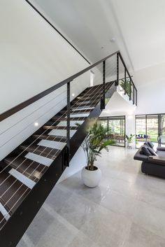 Custom steel plate staircase in Manley Homes award winning custom small lot home 2017