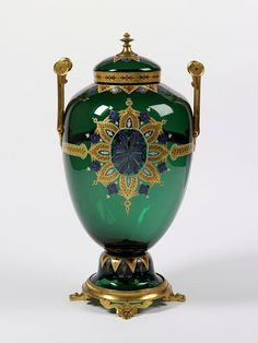 Vase and cover - Place of origin: Clichy, France  Date:1867 Artist/Maker: L Joseph Maës, Cristalleries de Clichy (manufacturer)   Appert Frères (manufacturer)Materials and Techniques: Coloured glass, with painted decoration in gilding and enamels