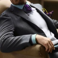 white and green stripe button up & purple tie.