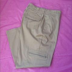 """Chicos Khaki Capris Cute lightweight capris w/ zippered cargo pocket on right leg. Side  pockets & back flap pockets. Stretchy fabric & elastic inserts on sides of the waistband make these comfortable all day! Waist lying flat 14 - 17.5"""". Hip 20"""" stretch to about 25"""". Inseam 27"""". Excellent like new condition. Only worn a couple times. Smoke free home. Chico's Pants Capris"""
