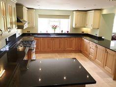 Black pearl granite with honey oak cabinets