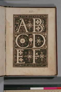 """f. xix   Alphabet, A-D, in white letters on a dark ground, entitled """"Letra Latina."""""""