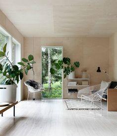 Natural living room. Feature with Bertoia Diamond Chair and Flos Parentesi lighting. Cottage of Minna Jones.