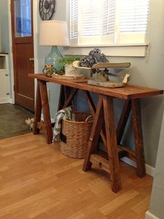 blue roof cabin: DIY Sawhorse Console Table