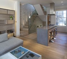Loft Apartments with Brick Walls | The new staircase is cantilevered off an exposed brick clad wall ...