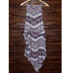"""FREE PEOPLE Dress Printed Cutout Back Swing Midi Size Small. New without tags. $128.   Strappy striped printed V-Back dress with a shapeless silhouette, high neckline, and oversized armholes.  Asymmetrical pleated hem.   *100% Rayon   Measurements for Small: Bust: 37""""  Length (longest): 44""""     ❗️ Please - no trades, PP, holds, or Modeling.   ✔️ Reasonable offers considered when submitted using the blue """"offer"""" button.    Bundle 2+ items for a 20% discount!    Stop by my closet for even more…"""