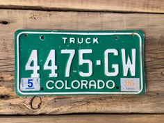 Colorado Truck License Plate Number 4475GW in Green with White Letters May 1995 Registration    #Truck #GreenLicense #CoLicensePlate #ManCave #4475GW #GreenAndWhite #Colorado #LicensePlate #Green #ColoradoTruck