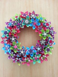 All Buttoned and Blingie. Frist attempt at a wreath and I LOVE it! #origami #flowers #christmas #decoration @Betty Le Bonbon   Flickr - Photo ...