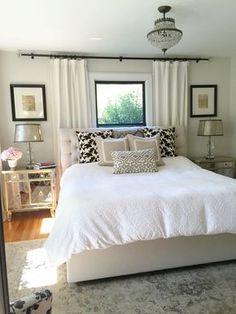 Neutral bedroom. Window behind bed. Bedroom window treatments. Paint is Benjamin Moore winds breath