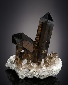 Smoky Quartz (also known as Smoky Topaz) is a powerful tool for spiritual cleansing. Wear this rejuvenating crystal to banish negativity and aid in meditation. Minerals And Gemstones, Rocks And Minerals, Natural Gemstones, Cool Rocks, Beautiful Rocks, Pierre Labradorite, Crystal Magic, Mineral Stone, Rocks And Gems