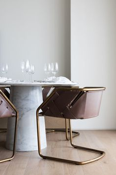 Marble pedestal and leather wrapped chairs, rustic chic dining.